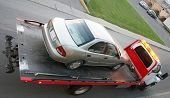 picture of towing  - Car being towed on a flatbed truck - JPG