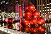 foto of rockefeller  - NEW YORK CITY - DEC. 25 2014: New York City landmark Radio City Music Hall in Rockefeller Center decorated with Christmas decorations in Midtown Manhattan NYC.