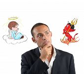 stock photo of interrogation  - A businessman undecided between good and evil - JPG
