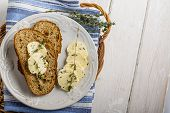picture of fresh slice bread  - Slices of fresh bread with butter on the grass - JPG