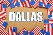 stock photo of texas state flag  - Miniature flags of the United States of America form a border on brown card around the name of the city of Dallas - JPG