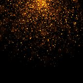picture of glitter sparkle  - gold glittering bokeh stars in dark background - JPG