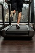 picture of treadmill  - Close Up Of Male Legs Running On Treadmill  - JPG