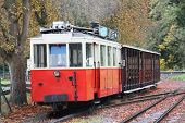 stock photo of red siding  - An old red tram waiting on a siding on their use