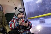 stock photo of tram  - Portrait of a child in the tram - JPG