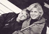 picture of ordinary woman  - middle age woman and a son outdoors - JPG
