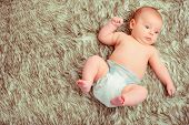 image of baby diapers  - Curious little baby - JPG