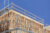 pic of scaffold  - Scaffolding and Wood Framing at Construction Site - JPG