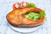 picture of butter-lettuce  - salmon steak with tomato and lettuce at restaurant - JPG