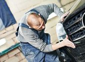 image of auto repair shop  - auto mechanic worker sanding polishing bumper car at automobile repair and renew service station shop by sandpaper - JPG