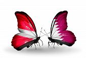 picture of qatar  - Two butterflies with flags on wings as symbol of relations Latvia and Qatar - JPG