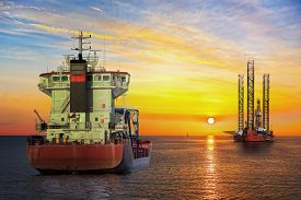 stock photo of fuel tanker  - Tanker ship and Oil Platform on offshore area at sunset - JPG