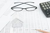 stock photo of spectacles  - Pencil and house on finance account with spectacles and calculator as background - JPG