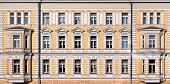 stock photo of neoclassical  - Closeup of the yellow neoclassic house in Moscow Russia - JPG
