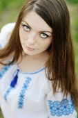 pic of freckle face  - girl with freckles on her face in a Ukrainian shirt - JPG