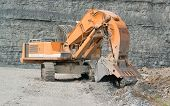 stock photo of excavator  - picture of a tracked excavator in a quarry - JPG