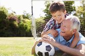 pic of grandfather  - Portrait Of Grandfather And Grandson With Football - JPG