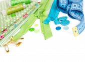 picture of zipper  - Accessories for sewing - fabric pins zipper thread buttons and measuring tape isolated on white background