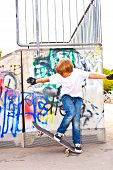 picture of skate  - boy resting with skate board at the skate park - JPG