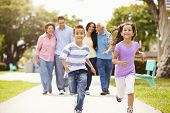 foto of children walking  - Multi Generation Family Walking In Park Together - JPG