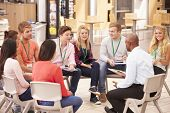 image of tutor  - College Students With Tutor Having Discussion - JPG