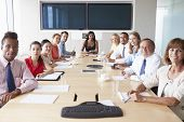 foto of pov  - Point Of View Shot Of Businesspeople Around Boardroom Table - JPG