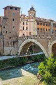 stock photo of pon  - pons fabricius on tiber island in rome - JPG