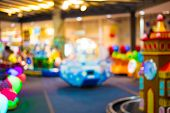 stock photo of arcade  - Arcade Game Machine Shop Blur Background With Bokeh Image  - JPG