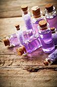 stock photo of gels  - Bottles with purple shower gel on wooden background - JPG