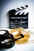 image of mm  - Movie clapper with 35 mm film on white background vertical frame vintage color effect - JPG