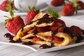 pic of crepes  - Delicious crepes with fresh strawberries and chocolate close - JPG