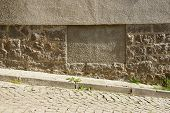 image of plinth  - set and shadows on the streets of the Bulgarian town of Sozopol - JPG
