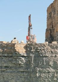pic of open-pit mine  - Construction drill auger in a open pit mine - JPG