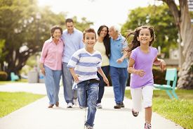 foto of grandparent child  - Multi Generation Family Walking In Park Together - JPG