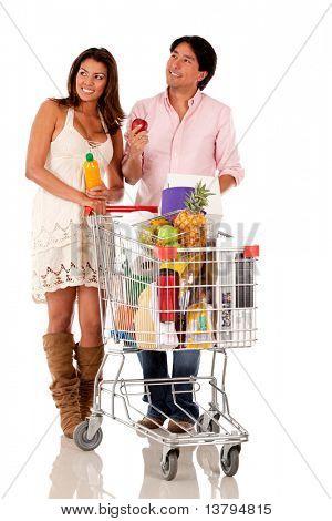 Постер, плакат: Пара с корзина ищет продукты изолированные, холст на подрамнике