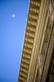 foto of corbel  - Architectural detail corbels and the moon in background - JPG