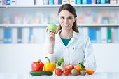 Smiling Nutritionist In Her Office poster
