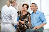 stock photo of elderly couple  - senior couple visiting a doctor at the doctor - JPG