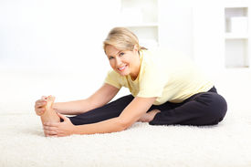 stock photo of workout-women  - Happy mature woman doing yoga - JPG