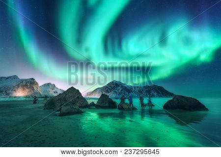 Green Aurora Borealis And People