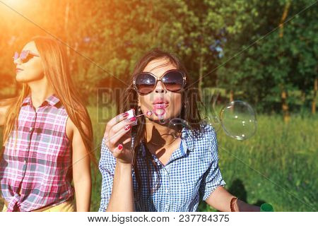 poster of Happy Friends In The Park On A Sunny Day . Summer Lifestyle Portrait Of Three Hipster Women Enjoy Ni