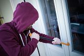 Hooded Burglar Forcing Window To Rob In The House poster