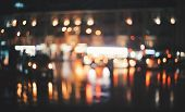 Blurred City At Night. Bokeh. Beautiful Abstract Background With Defocused Buildings, Cars, City Lig poster