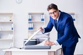 Businessman making copies in copying machine poster