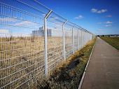 Steel Lattice Fence, Metal Wire Fence With Grass In The Background poster