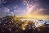 Tropical Rocky Coast Of The Ocean During Sunrise With Sunbeams Mirissa, Sri Lanka poster