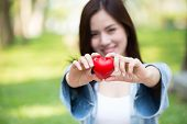 Giving Love Together Concept: Cute Asian Woman Hold Red Heart For Loving Sharing Lovely poster