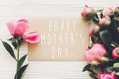 Happy Mothers Day Text On Craft Card And Pink Peonies Bouquet On Rustic White Wooden Background In  poster