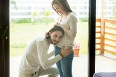 Happy Loving Dad-to-be Puts Ear Touching Pregnant Wife Belly Listening To Baby Inside, Excited Famil poster