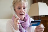 Senior Woman Giving Credit Card Details On The Phone poster